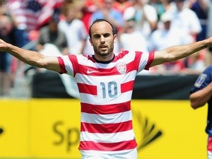Striker Landon Donovan celebrates scoring for the USA on July 13, 2013.