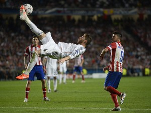 Real Madrid's defender Sergio Ramos jumps to kick the ball during the UEFA Champions League Final Real Madrid vs Atletico de Madrid at Luz stadium in Lisbon, on May 24, 2014