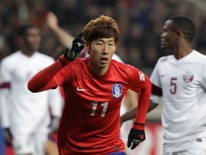 Son Heung-Min celebrates scoring for South Korea on March 26, 2013.
