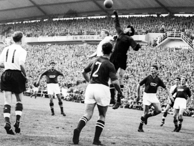 Soviet Union goalkeeper Lev Yashin punches clear against England on June 98, 1958.