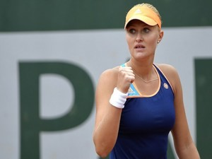 France's Kristina Mladenovic reacts during her French tennis Open first round match against China's Li Na at the Roland Garros stadium in Paris on May 27, 2014
