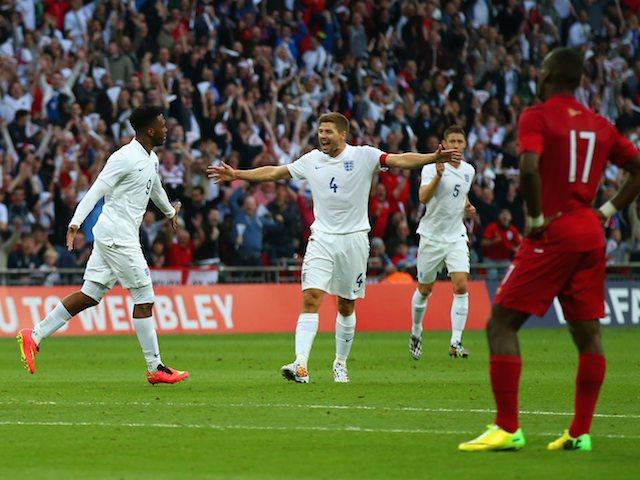 Steven Gerrard congratulates Daniel Sturridge for scoring England's opener against Peru on May 30, 2014