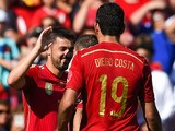 David Villa (C) celebrates with his teammates after scoring the opening goal of Spain during an international friendly match against El Salvador on June 7, 2014