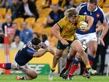 Michael Hooper of the Wallabies breaks through the defence during the First International Test Match on June 7, 2014