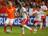 Arjen Robben of Netherlands runs on goal followed by Daniel Gabbidon and Joe Allen of Wales during the International Friendly match between The Netherlands and Wales at Amsterdam Arena on June 4, 2014