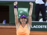 Romania's Simona Halep celebrates after winning her French tennis Open semi-final match against Germany's Andrea Petkovic at the Roland Garros stadium in Paris on June 5, 2014