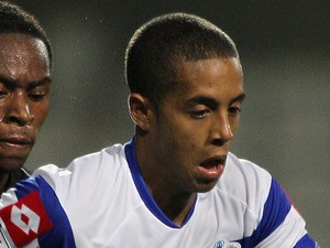 Bruno Andrade of Queens Park Rangers battle for the ball during the Carling Cup second round match on August 23, 2011