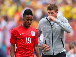 Steven Gerrard of England speaks with Raheem Sterling of England after he was shown a red card during the International friendly match between England and Ecuador at Sun Life Stadium on June 4, 2014