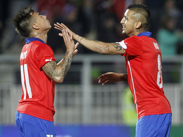 Chilean national team footballer Eduardo Vargas celebrates next to Arturo Vidal after scoring against North ireland during a friendly football match in Valparaiso, on June 4, 2014