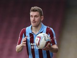 Andy Dawson of Scunthorpe United in action during the Sky Bet League Two match between Scunthorpe United and Northampton Town at Glanford Park on March 8, 2014