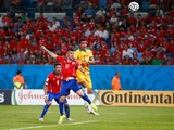 Tim Cahill of Australia goes up for a header against Gary Medel of Chile and scores a goal during the 2014 FIFA World Cup Brazil Group B match between Chile and Australia at Arena Pantanal on June 13, 2014