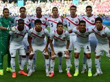Costa Rica players line up for a photo before a Group D football match between Uruguay and Costa Rica at the Castelao Stadium in Fortaleza during the 2014 FIFA World Cup on June 14, 2014