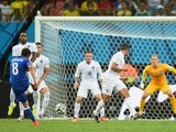 Claudio Marchisio of Italy shoots and scores his team's first goal during the 2014 FIFA World Cup Brazil Group D match between England and Italy at Arena Amazonia on June 14, 2014