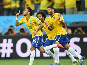 Neymar of Brazil celebrates scoring a first half goal with Marcelo and Hulk during the 2014 FIFA World Cup Brazil Group A match between Brazil and Croatia at Arena de Sao Paulo on June 12, 2014