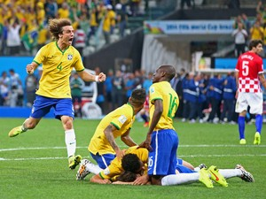 David Luiz of Brazil celebrates with teammates after a goal by Oscar in the second half during the 2014 FIFA World Cup Brazil Group A match between Brazil and Croatia at Arena de Sao Paulo on June 12, 2014