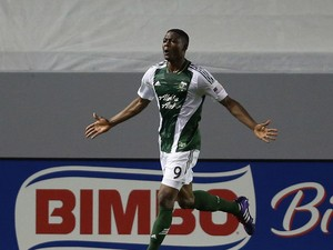 Fanendo Adi #9 of the Portland Timbers celebrates his second half goal, as Eric Avila #15 of Chivas USA looks on at StubHub Center on May 28, 2014