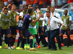 Robin van Persie of the Netherlands celebrates with head coach Louis van Gaal of the Netherlands after scoring the teams first goal in the first half during the 2014 FIFA World Cup Brazil Group B match between Spain and Netherlands at Arena Fonte Nova on