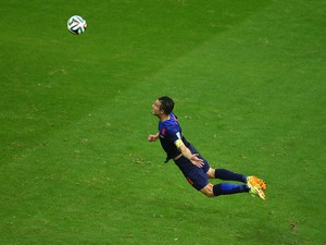 Robin van Persie of the Netherlands scores the teams first goal with a diving header in the first half during the 2014 FIFA World Cup Brazil Group B match between Spain and Netherlands at Arena Fonte Nova on June 13, 2014