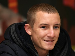 Paul Butler answers questions from the press during a press conference at Aintree Racecourse on January 9, 2014