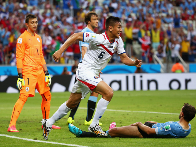 Oscar Duarte of Costa Rica celebrates after scoring his team's second goal past Fernando Muslera of Uruguay during the 2014 FIFA World Cup Brazil Group D match between Uruguay and Costa Rica at Castelao on June 14, 2014