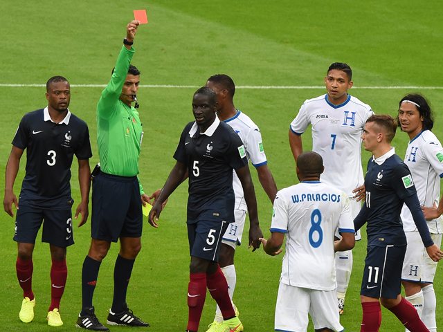 Honduras' midfielder Wilson Palacios receives a red card from Brazilian referee Sandro Meira Ricci during a Group E football match between France and Honduras at the Beira-Rio Stadium in Porto Alegre during the 2014 FIFA World Cup on June 15, 2014