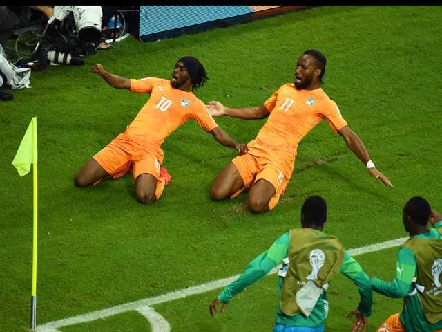 Gervinho of the Ivory Coast celebrates scoring his team's second goal with teammate Didier Drogba during the 2014 FIFA World Cup Brazil Group C match between the Ivory Coast and Japan at Arena Pernambuco on June 14, 2014