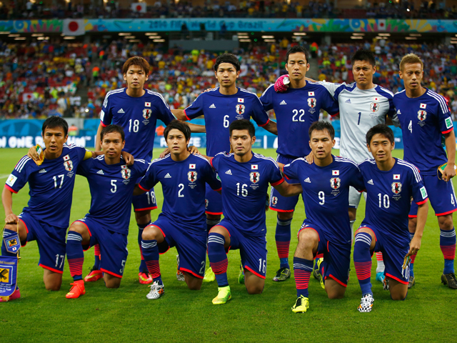 Japan pose for a team photo before the 2014 FIFA World Cup Brazil Group C match between the Ivory Coast and Japan at Arena Pernambuco on June 14, 2014