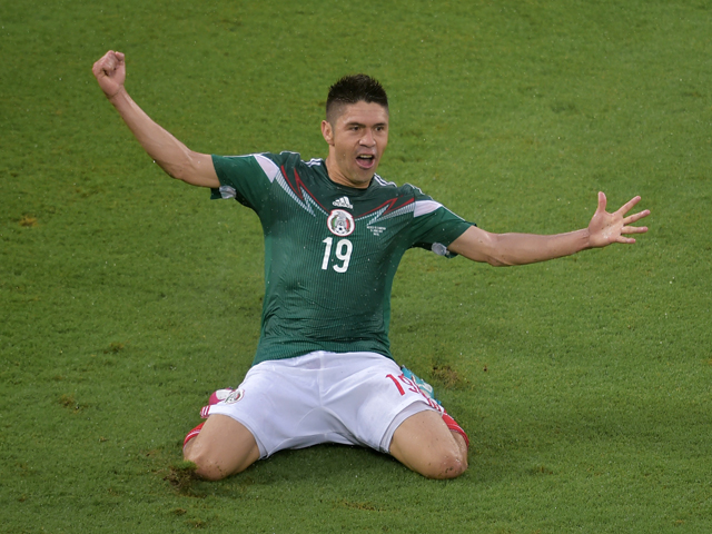 Mexico's forward Oribe Peralta celebrates after scoring a goal during the Group A football match between Mexico and Cameroon at the Dunas Arena in Natal during the 2014 FIFA World Cup on June 13, 2014