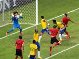 Guillermo Ochoa of Mexico makes a save after a header by Thiago Silva of Brazil during the World Cup Group A match in Fortaleza on June 17, 2014