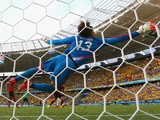 Mexico goalkeeper Guillermo Ocha dives at full stretch to make a save during the World Cup Group A match in Fortaleza against Brazil on June 17, 2014
