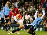 Joe Cole, in action for England, shoots for goal against Uruguay on March 01, 2006.