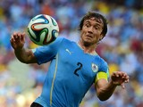 Uruguay's defender Diego Lugano in action during a Group D football match between Uruguay and Costa Rica at the Castelao Stadium in Fortaleza during the 2014 FIFA World Cup on June 14, 2014