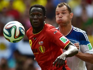 Russia's defender and captain Sergey Ignashevich watches Belgium's forward Romelu Lukaku control the ball during the Group H football match between Belgium and Russia at The Maracana Stadium in Rio de Janeiro on June 22, 2014