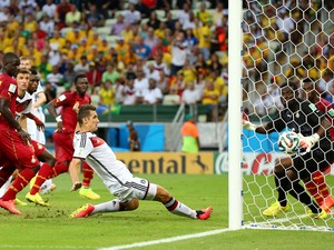 Miroslav Klose of Germany scores his team's second goal past Fatawu Dauda of Ghana during the 2014 FIFA World Cup Brazil Group G match between Germany and Ghana at Castelao on June 21, 2014