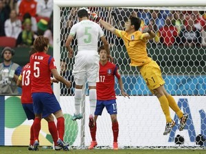 Algeria's defender Rafik Halliche scores in the nets of South Korea's goalkeeper Jung Sung-Ryong during a Group H football match on June 22, 2014