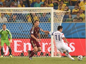 South Korea's forward Lee Keun-Ho scores the 0-1 goal during the Group H football match between Russia and South Korea in the Pantanal Arena in Cuiaba during the 2014 FIFA World Cup on June 17, 2014