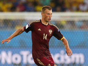 Vasily Berezutskiy of Russia controls the ball during the 2014 FIFA World Cup Brazil Group H match between Russia and South Korea at Arena Pantanal on June 17, 2014