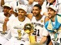 Kawhi Leonard, Tony Parker, Tim Duncan and Manu Ginobili of the San Antonio Spurs celebrate with the Larry O'Brien trophy after winning the NBA title on June 15, 2014