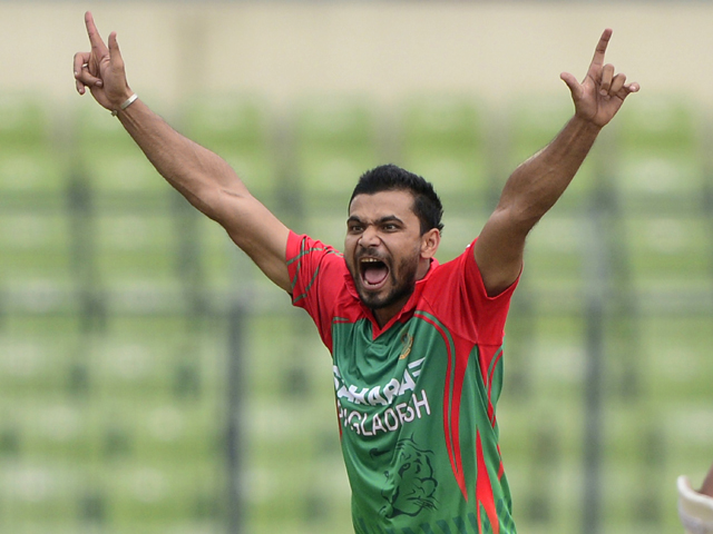 Bangladeshi cricketer Mashrafe Bin Mortaza successfully appeals for a leg before wicket decision against Indian cricketer Ajinkya Rahane during the second One Day International (ODI) cricket match between India and Bangladesh at the Sher-e-Bangla National