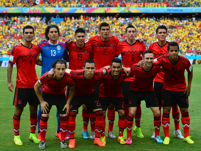 Mexico players pose before a Group A football match between Brazil and Mexico in the Castelao Stadium in Fortaleza during the 2014 FIFA World Cup on June 17, 2014