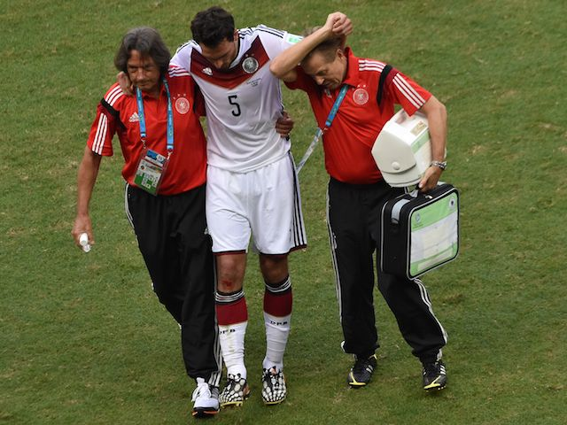 Mats Hummels is taken off injured during Germany's 4-0 victory over Portugal on June 16, 2014.