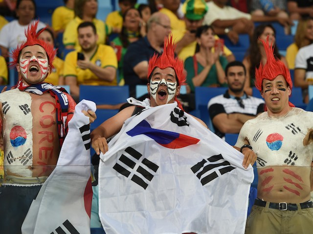 South Korean fans react prior to a Group H football match between Russia and South Korea in the Pantanal Arena in Cuiaba during the 2014 FIFA World Cup on June 17, 2014