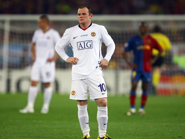 Wayne Rooney looks on dejected after Manchester United concede a goal against Barcelona on May 27, 2009.
