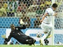 Greece's midfielder Andreas Samaris scores in the nets of Ivory Coast's goalkeeper Boubacar Barry during a Group C football match on June 24, 2014