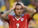 Chile's forward Mauricio Pinilla reacts after missing a shot on goal during extra-time of the Round of 16 football match between Brazil and Chile at the Mineirao Stadium in Belo Horizonte during the 2014 FIFA World Cup on June 28, 2014