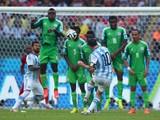 Lionel Messi of Argentina scores his team