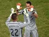 Colombia's goalkeeper David Ospina (R) is substitued by Colombia's goalkeeper Faryd Mondragon during a Group C football match on June 24, 2014
