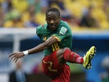 Cameroon's midfielder Enoh Eyong kicks the ball during the Group A football match between Cameroon and Brazil at the Mane Garrincha National Stadium in Brasilia during the 2014 FIFA World Cup on June 23, 2014