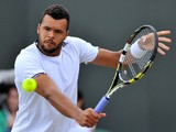 France's Jo-Wilfried Tsonga returns to Taiwan's Jimmy Wang during their men's singles third round match on day five of the 2014 Wimbledon Championships at The All England Tennis Club in Wimbledon, southwest London, on June 27, 2014