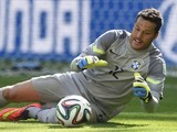 Brazil's goalkeeper Julio Cesar makes a save during the round of 16 football match between Brazil and Chile at The Mineirao Stadium in Belo Horizonte during the 2014 FIFA World Cup on June 28, 2014